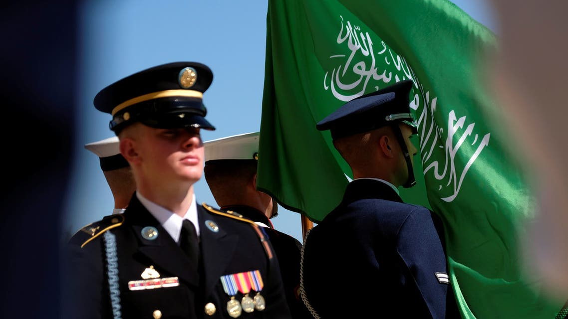 The flag of the Kingdom of Saudi Arabia flies in the face of a member of a U.S. military honor guard awaiting the arrival of the Kingdom's Deputy Defense Minister Prince Khalid bin Salman at the Pentagon in Washington, U.S., August 29, 2019. (Reuters)