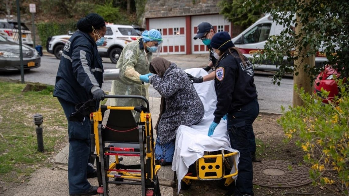 Empress EMS paramedics transport a patient with COVID-19 symptoms to a hospital on April 17, 2020 in Yonkers, New York. (AFP)