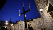 Christians mark Good Friday as holy sites gradually reopen