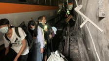 Taiwan prosecutors seek arrest warrant for suspect in deadly train crash