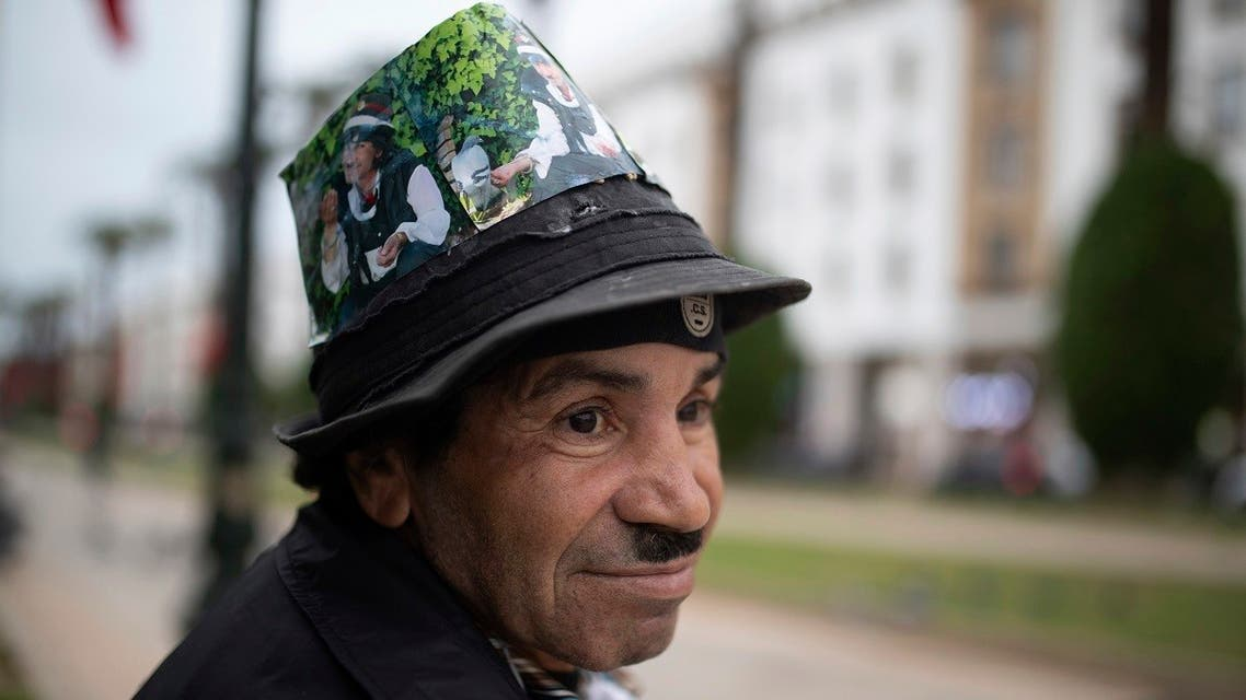 Belhussein Abdelsalam, a Charlie Chaplin impersonator pauses while waiting for customers in an avenue in Rabat, Morocco. (AP)