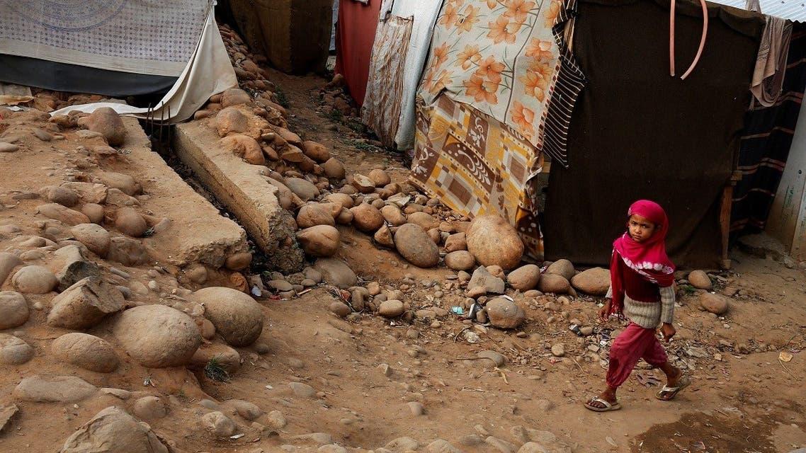 A girl belonging to Rohingya Muslim community walks past a makeshift settlement on the outskirts of Jammu, India. (File photo: Reuters)