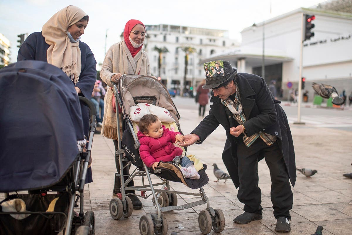 Belhussein Abdelsalam, a Charlie Chaplin impersonator reacts while performing for some children, in an avenue in Rabat, Morocco. (AP)