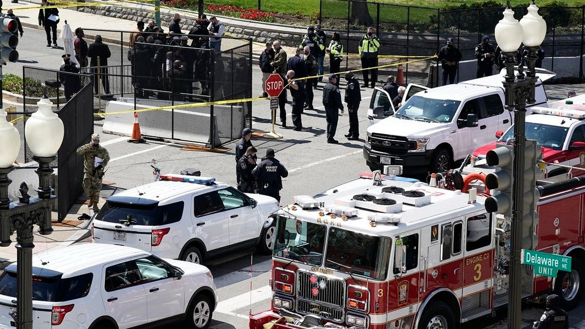 Police and fire officials stand near a car that crashed into a barrier on Capitol Hill April 2, 2021. (AP)