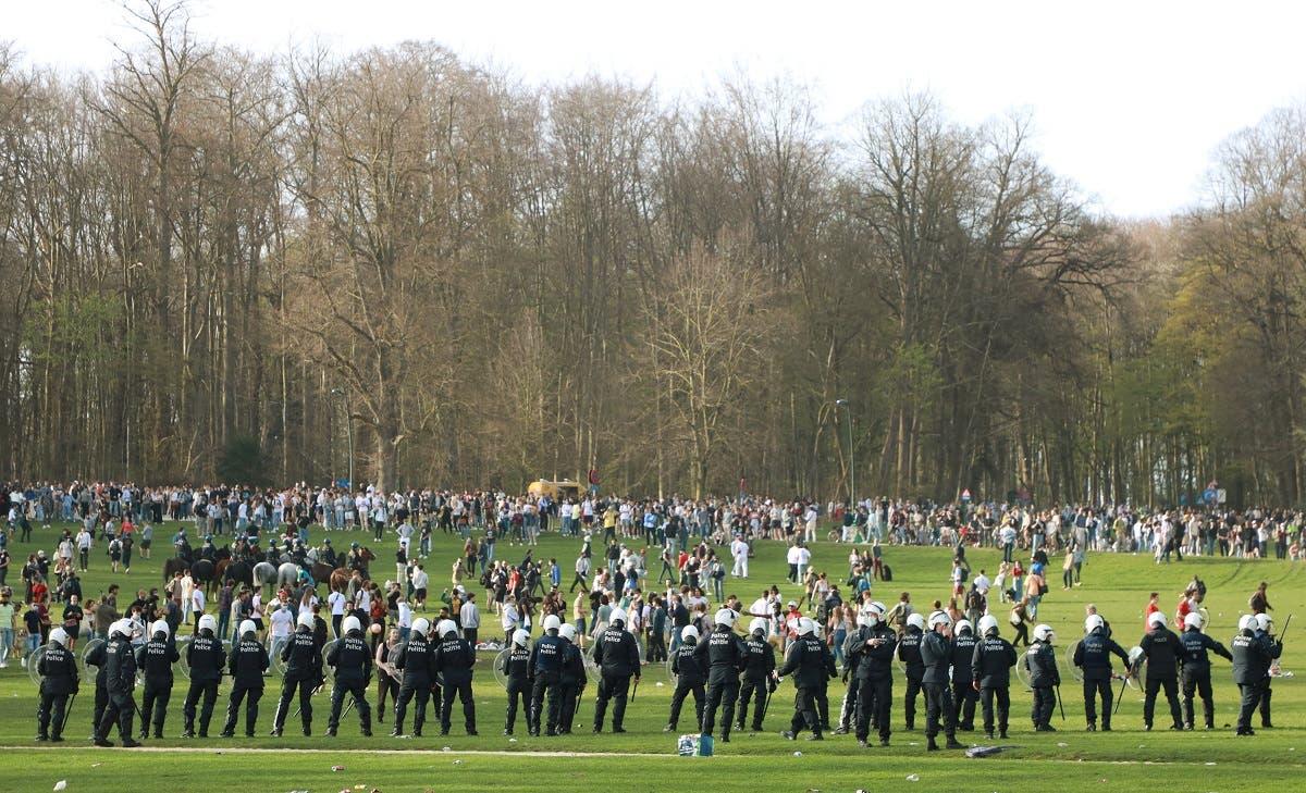 Belgian police forces dispersing young people gathering at the Bois de la Cambre/Ter Kamerenbos park in Brussels, Belgium, on April 1, 2021. (Reuters)