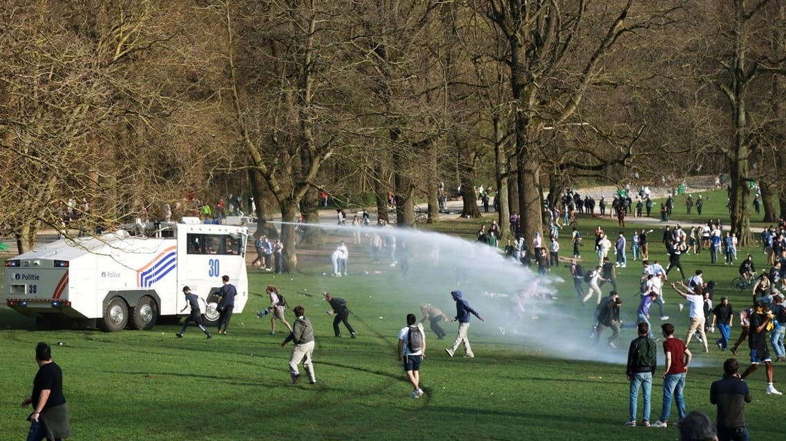 Belgian police forces disperse young people gathering at the Bois de la Cambre/Ter Kamerenbos park for a party in defiance of Belgium's coronavirus disease (COVID-19) social distancing measures and restrictions, in Brussels, Belgium, on April 1, 2021. (Reuters)