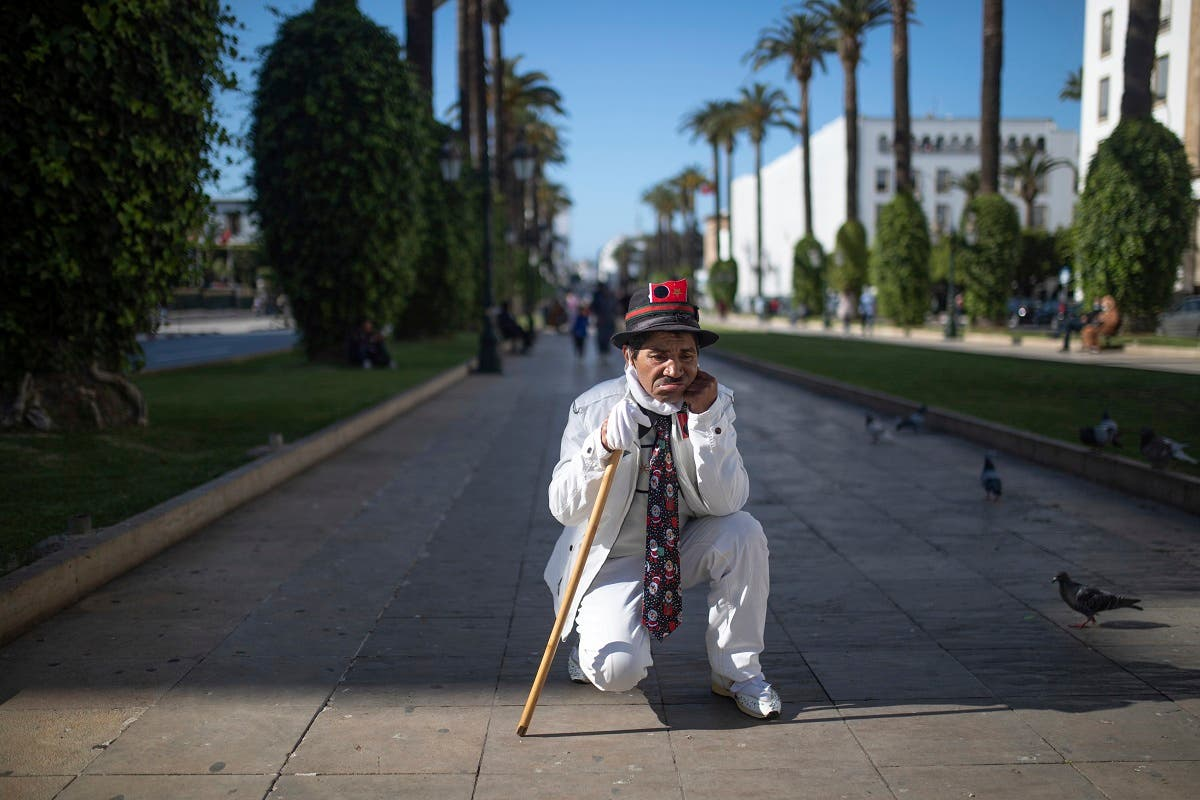Belhussein Abdelsalam, a Charlie Chaplin impersonator performs on a main avenue in Rabat, Morocco. (AP)