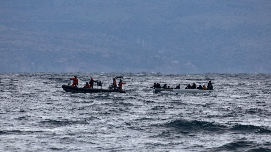 Migrants from sub-saharan African countries on a dinghy are towed by a rescue boat as they try to cross part of the Aegean Sea from Turkey to the island of Lesbos, Greece, February 29, 2020. (Reuters)