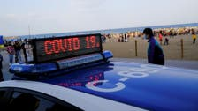 Beach partygoers in Spain's Barcelona defy COVID-19 measures