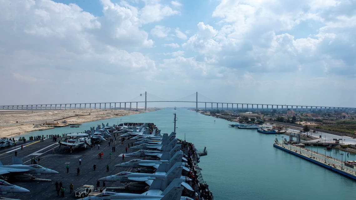 United States Navy aircraft carrier USS Dwight D. Eisenhower (CVN 69) approaches the Friendship Bridge during a Suez Canal transit in this picture taken April 2, 2021 and released by US Navy on April 3, 2021. (Reuters)