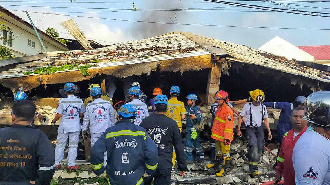 This handout from the Poh Teck Tung Foundation taken and released on April 3, 2021 shows rescue workers at the site of a building collapse in Bangkok. (AFP)