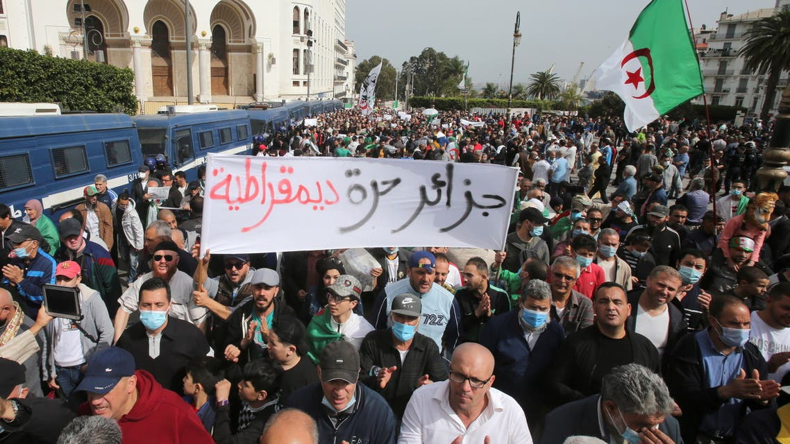 Demonstrators gesture as they take part in a protest demanding political change, in Algiers, Algeria April 2, 2021. (Reuters)