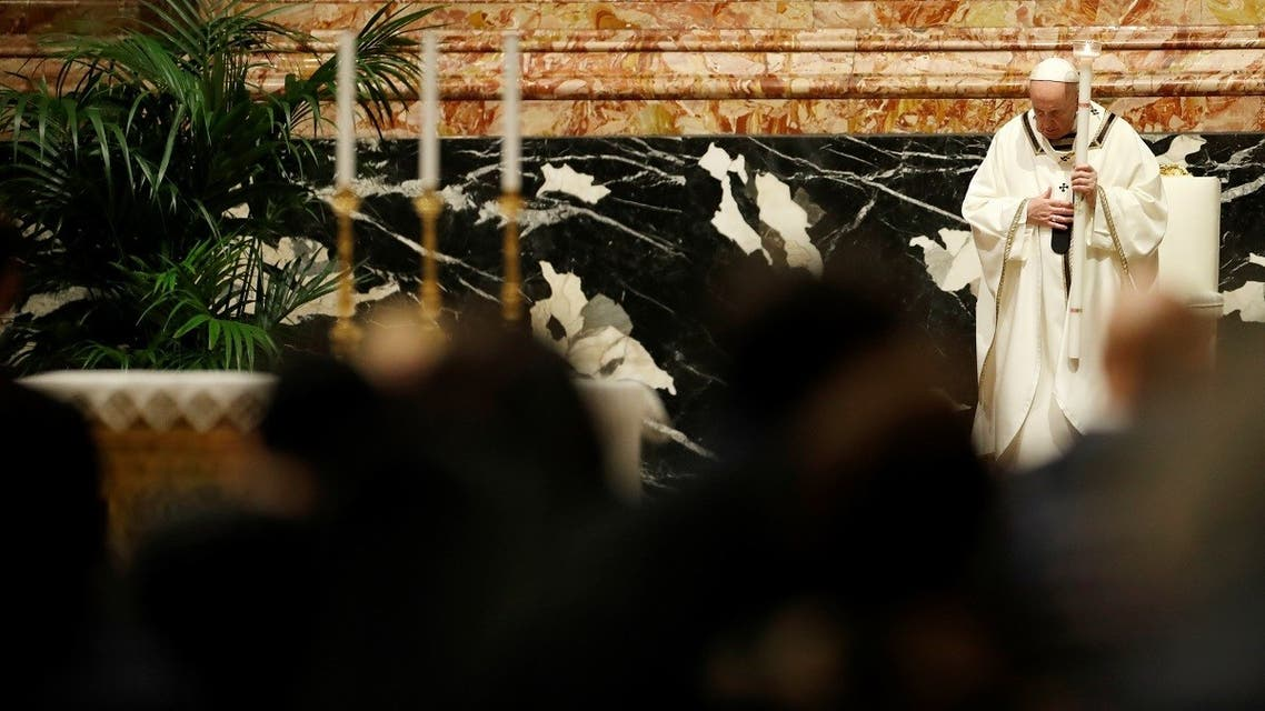 Pope Francis celebrates the Easter Vigil in a near empty St. Peter's Basilica as coronavirus disease restrictions stay in place for a second year running, at the Vatican, April 3, 2021. (Reuters/Remo Casilli/Pool)