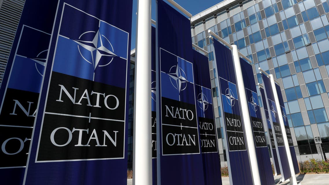 FILE PHOTO: Banners displaying the NATO logo are placed at the entrance of new NATO headquarters during the move to the new building, in Brussels, Belgium. (File photo: Reuters)