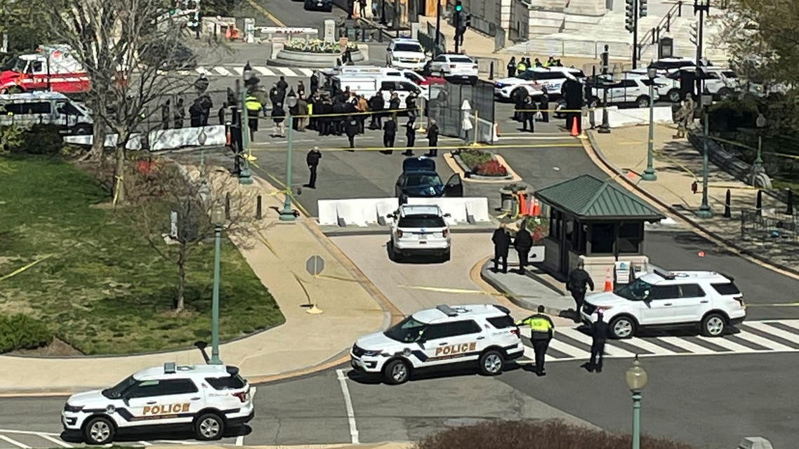 U.S. Capitol police surround a blue car that rammed a police barricade outside the U.S. Capitol building. (Reuters)