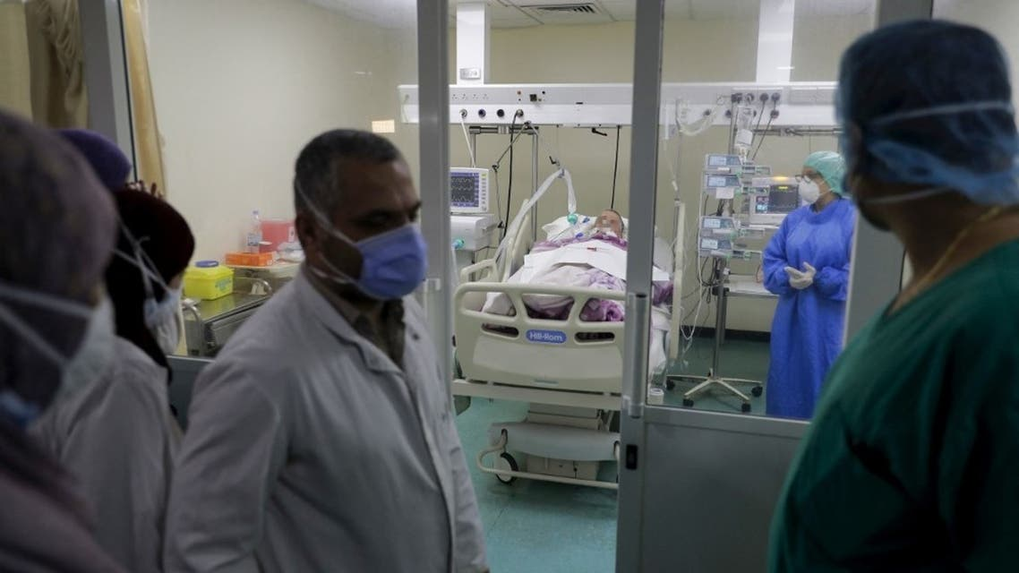 Doctors perform rounds in the intensive care unit of the Rafic Hariri University Hospital in the Lebanese capital Beirut, on November 13, 2020. (AFP)