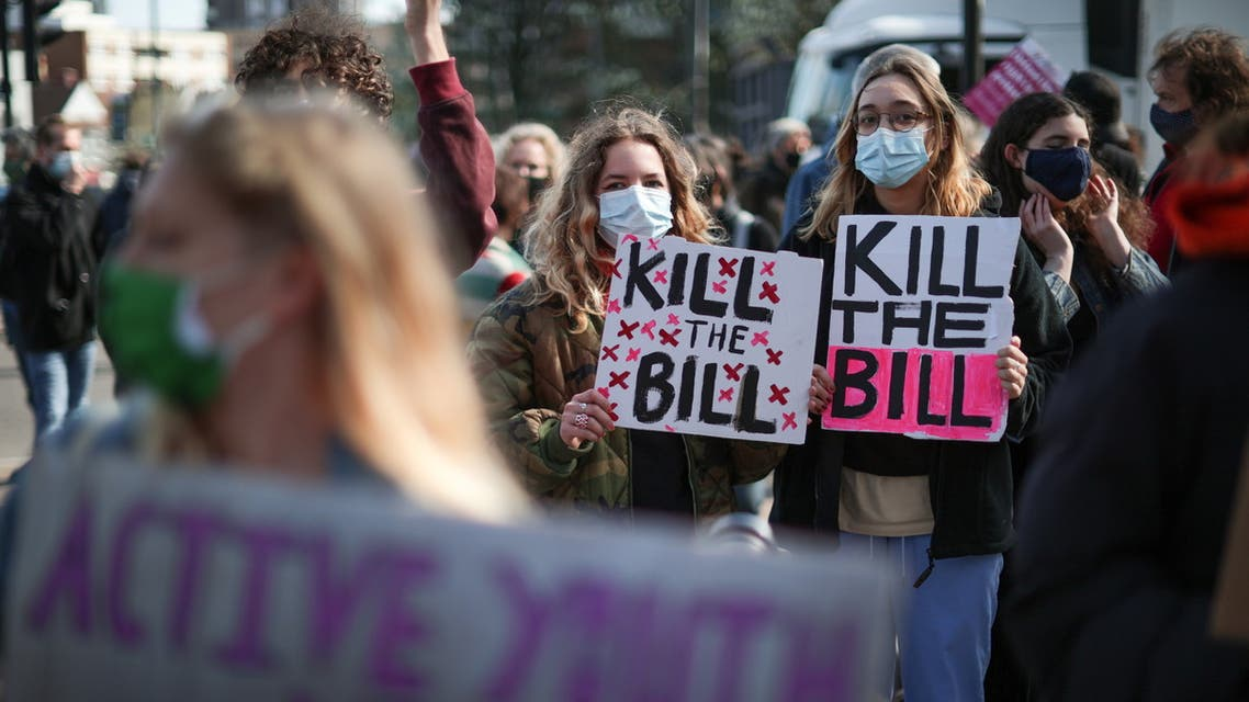 Demonstrators hold placards during a protest against a newly proposed policing bill in Finsbury Park in London, Britain, April 2, 2021. (Reuters)