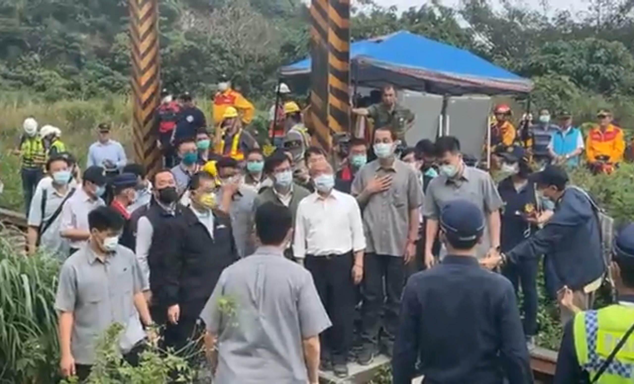 Taiwan's Premier Su Tseng-chang visits the site of a train crash north of Hualien, Taiwan April 2, 2021, in this still image taken from video. (Reuters)