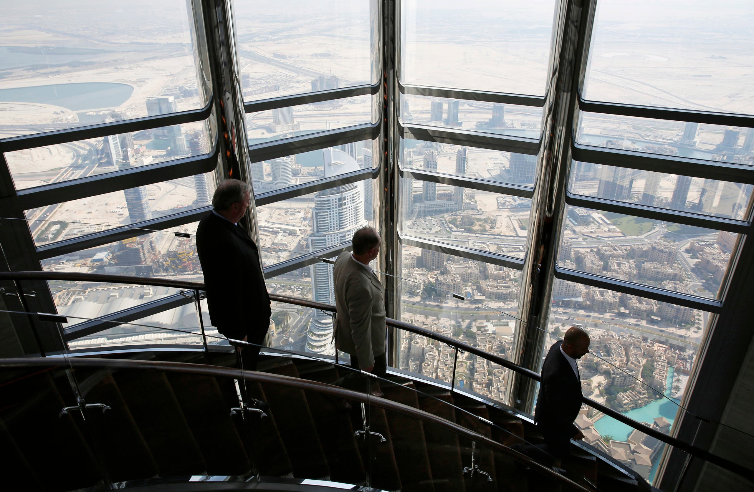 Businessmen walk down the stairs at the 123rd floor of the Burj Khalifa, the tallest building in the world, in Dubai. (File photo: Reuters)