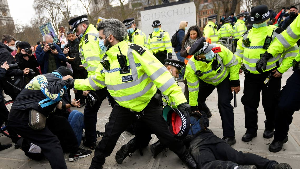 Police officers restrain demonstrators during a protest in London, Britain, April 3, 2021. (Reuters)