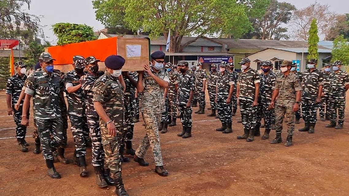 Members of Indian security forces carry the coffin of one of their colleague, who died following a gun battle with Maoist rebels, which left twenty-two members of Indian security forces killed and 30 others wounded, at the Central Reserve Police Force's Jagdalpur camp in Bijapur district of India's Chhattisgarh state on April 4, 2021. (AFP)