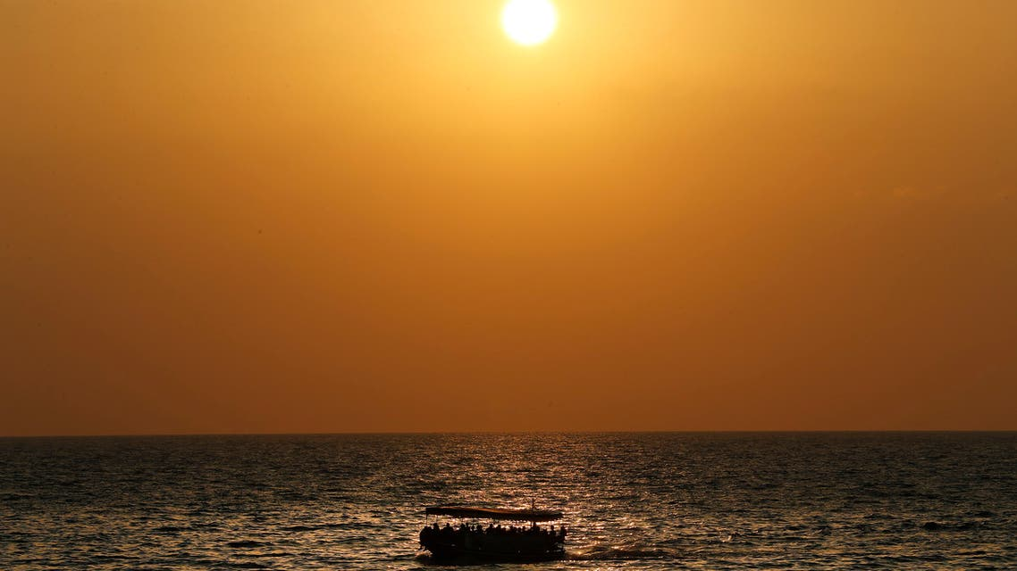 Lebanese ride a boat as they tour on the coast of Tripoli city, north Lebanon Thursday, Sept. 17, 2020. (File photo: AP)