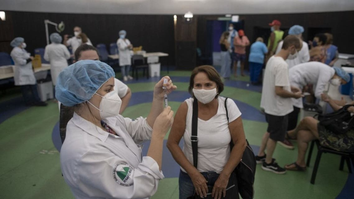A nurse prepares a dose of China's Sinovac CoronaVac vaccine produced by Butantan, the largest vaccine producer in Brazil, at a vaccination centre against the novel coronavirus, COVID-19, mounted at the Public Planetarium in Rio de Janeiro, on March 31, 2021. (AFP)