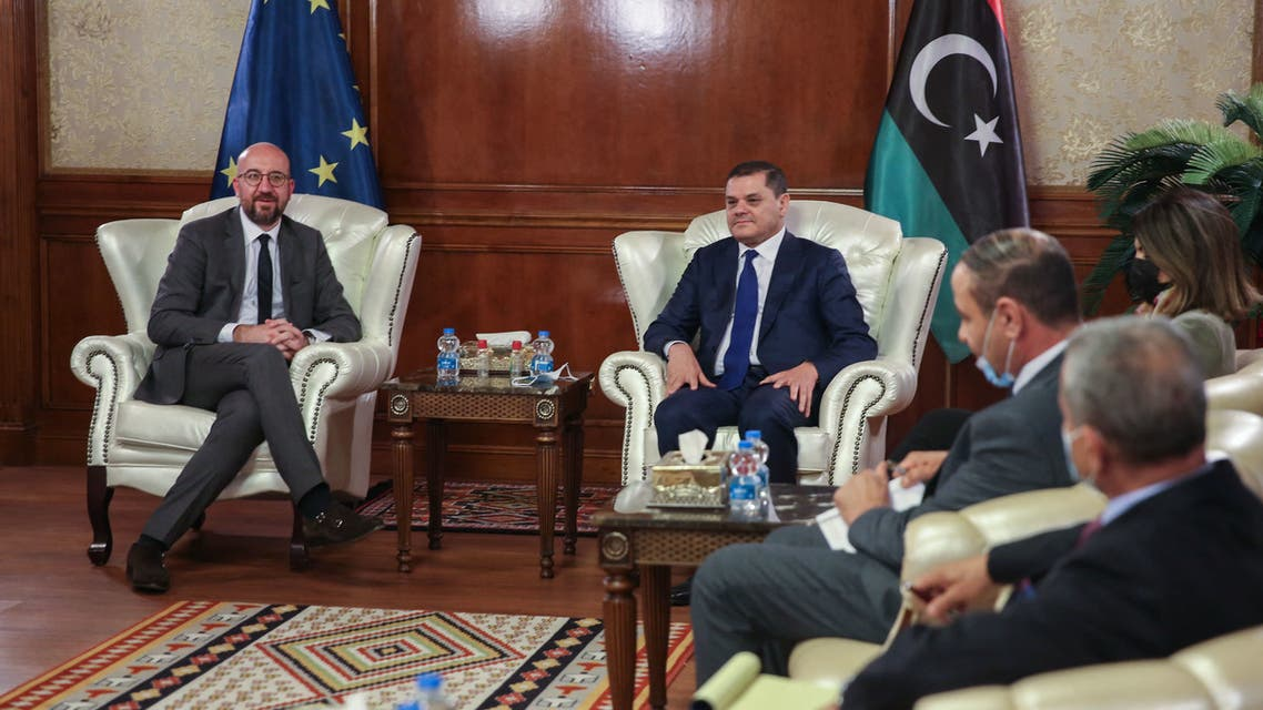 Libya's interim prime minister Abdul Hamid Dbeibah (R) meets with European Council President Charles Michel at the pesidential council headquarters in the capital Tripoli, on April 4, 2021. (AFP)