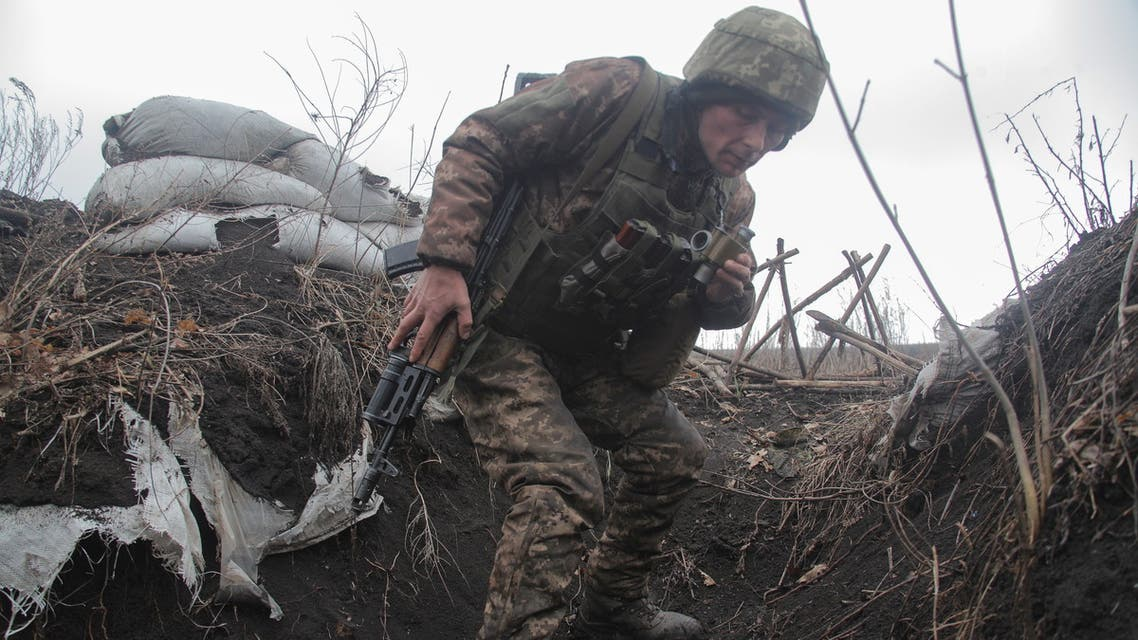A service member of the Ukrainian armed forces walks at fighting positions on the line of separation near the rebel-controlled city of Donetsk, Ukraine April 3, 2021. REUTERS/Serhiy Takhmazov