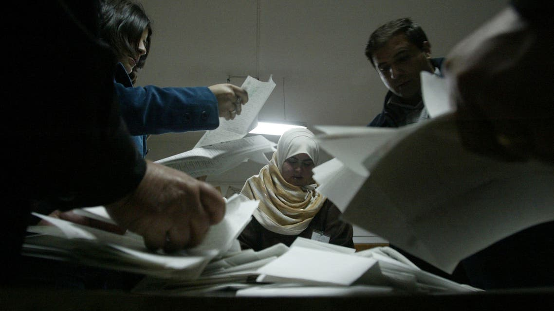 Palestinian elections officials start counting the ballots after voting was declared closed in the West Bank city of Ramallah 25 January 2006. The ruling Fatah faction claimed Wednesday to have fended off an unprecedented challenge to its power from the Islamist Hamas group in the second Palestinian election, whose result promises to have a profound impact on the Middle East peace process. AFP PHOTO/JAMAL ARURI