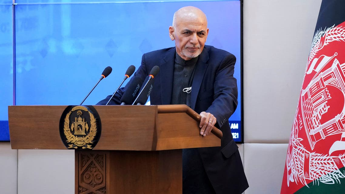 This handout photograph taken on February 23, 2021 and released by the Press Office of President of Afghanistan shows Afghan President Ashraf Ghani speaking during a ceremony at the Presidential Palace in Kabul, as Afghanistan launched a Covid-19 vaccination campaign.