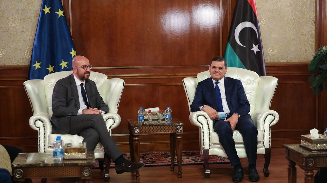 Libya's interim prime minister Abdul Hamid Dbeibah (R) meets with European Council President Charles Michel at the pesidential council headquarters in the capital Tripoli, on April 4, 2021. Michel arrived in Tripoli as Libya seeks to build a unity government and end a decade of chaos following a NATO-backed 2011 revolt.
