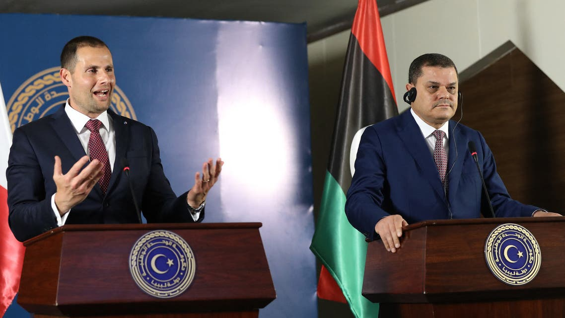 (R to L) Libya's interim prime minister Abdul Hamid Dbeibah and Malta's visiting Prime Minister Robert Abela give a joint press conference at the prime minister's office in the capital Tripoli on April 5, 2021.