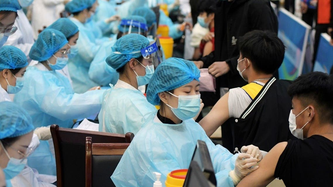 Medical workers inoculate students with the vaccine against the coronavirus disease (COVID-19) at a university in Qingdao, Shandong province, China March 30, 2021. (Reuters)