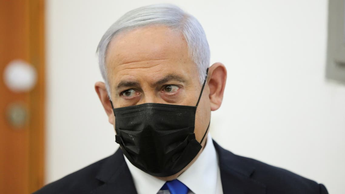 Israeli Prime Minister Benjamin Netanyahu, wearing a face mask, looks as his corruption trial resumes, at Jerusalem's District Court April 5, 2021. (Reuters)