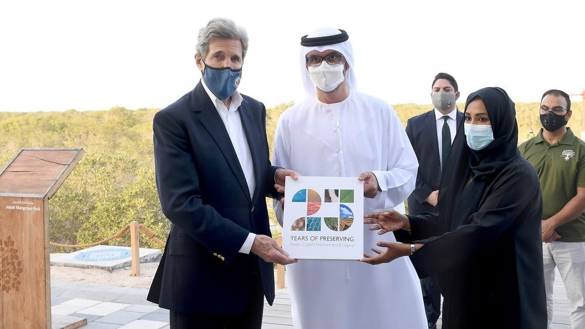 US Special Envoy for Climate John Kerry poses alongside UAE Special Envoy for Climate Change and Abu Dhabi National Oil Company CEO, Sultan Ahmed Al Jaber, at Jubail Mangrove Park, April 3, 2021. (Reuters)