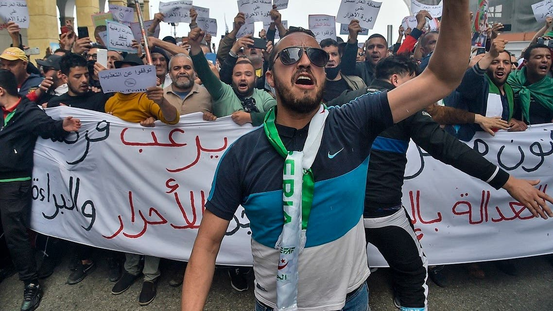 Algerians shout slogans during an anti-government demonstration in the capital Algiers on April 2, 2021. (Ryad Kramdi/AFP)