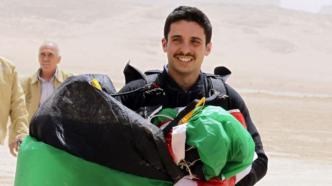 In this file photo taken on April 17, 2012 shows Jordanian Prince Hamzah bin al-Hussein, president of the Royal Aero Sports Club of Jordan, carries a parachute during a media event to announce the launch of Skydive Jordan, in the Wadi Rum desert. (AFP)