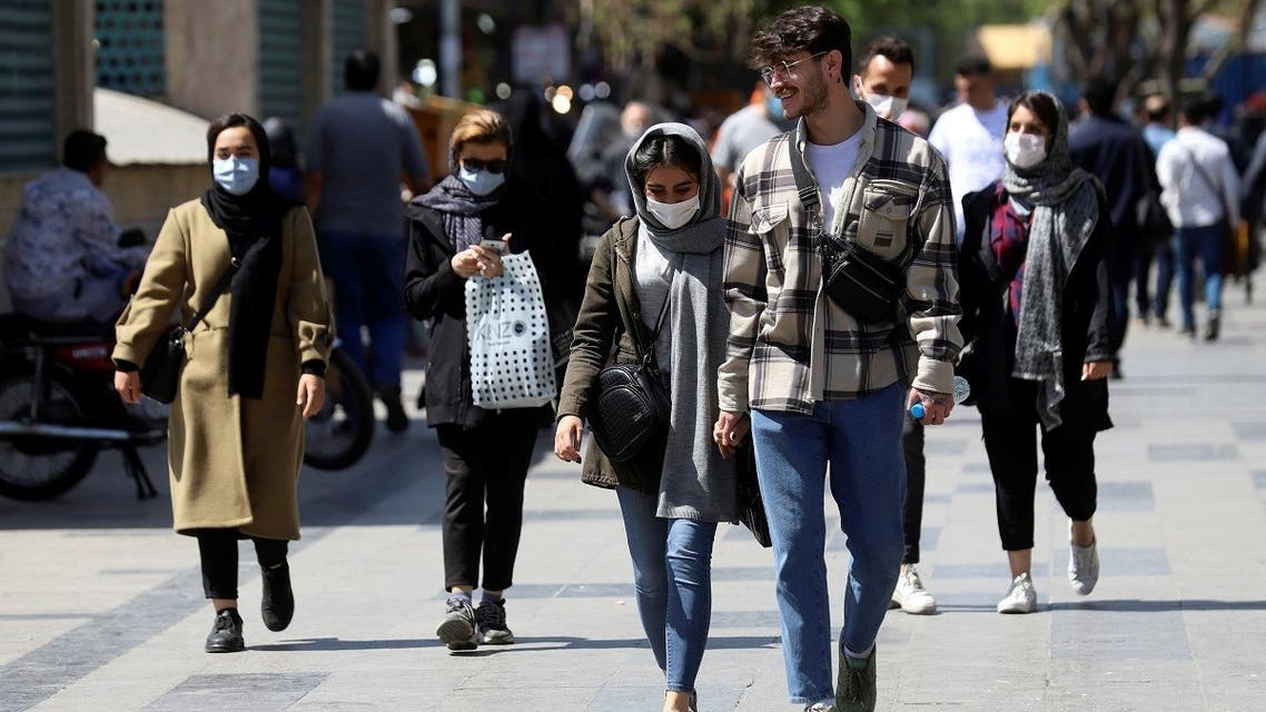 Iranian people wear protective face masks, as they walk amid the spread of the coronavirus disease (COVID-19), in Tehran, Iran March 30, 2021. (Reuters)