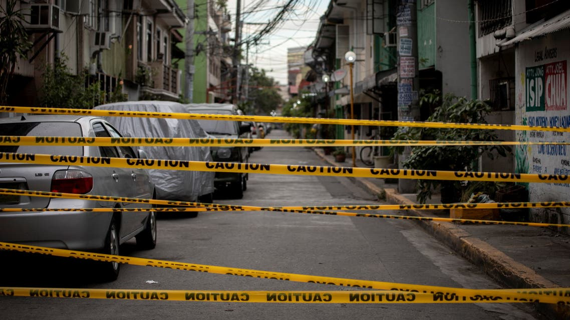 A view shows a makeshift barrier set up on a street of a village under lockdown amid rising coronavirus disease (COVID-19) infections, in Manila, Philippines, March 12, 2021. (Reuters)
