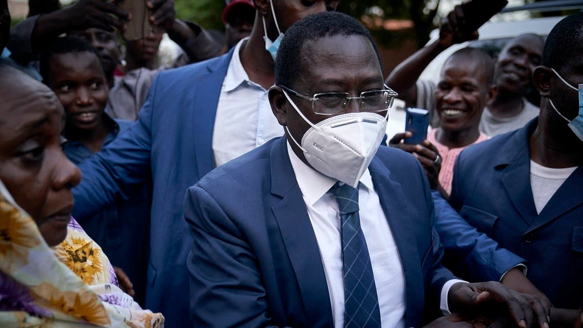 Malian politician Soumaila Cisse greets supporters as he arrives at his home in Bamako, on October 9, 2020, a day after his release. (Michele Cattani/AFP)