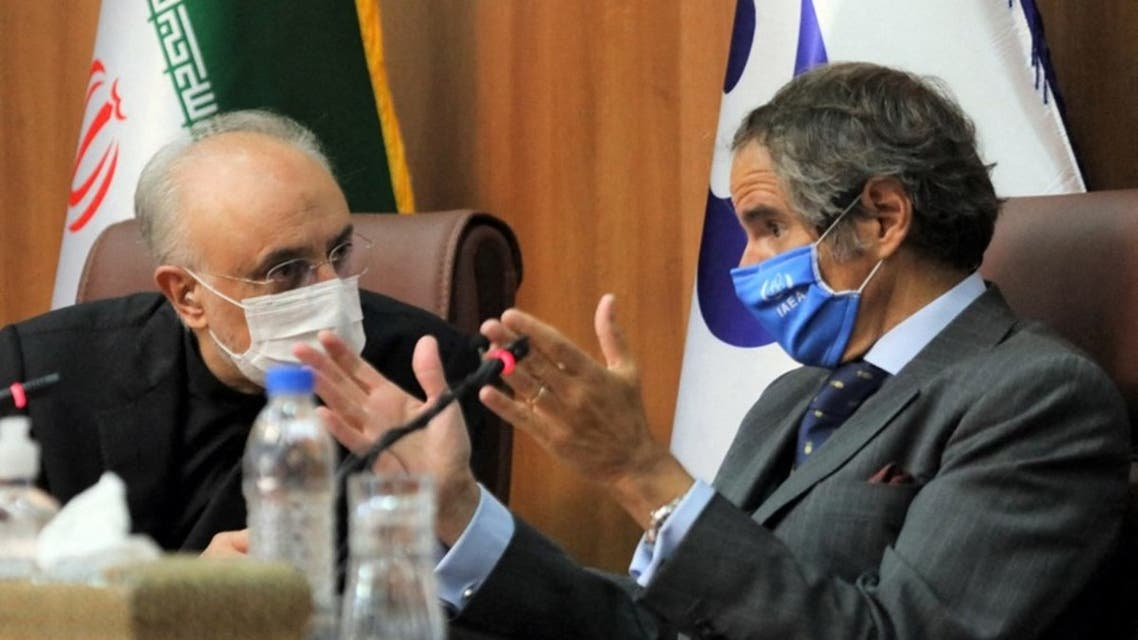 A handout picture provided by Iran's Atomic Energy Organisation shows the head of the country's atomic agency Ali Akbar Salehi (L) and Director General of the International Atomic Energy Agency (IAEA) Rafael Mariano Grossi holding a joint press conference in Tehran on August 25 2020. (AFP)