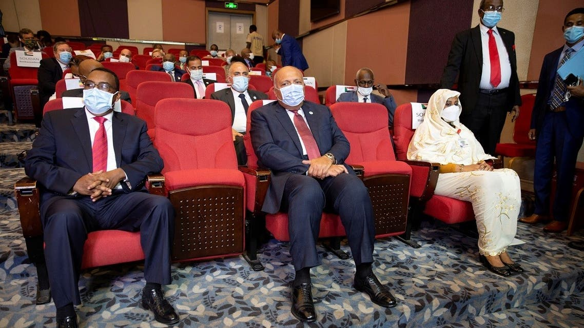 Ethiopia's Foreign Minister Demeke Mekonnen, Egypt's Foreign Minister Sameh Shoukry, and Sudan's Foreign Minister Asma Mohamed Abdalla sit in a theater in the Fleuve Congo Hotel in Kinshasa in the Democratic Republic of Congo, on April 4, 2021. (Reuters)