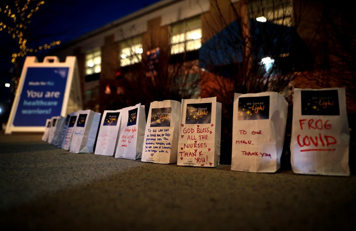 Messages written on small bags with lights in them are pictured outside Northern Westchester Hospital during a ceremony to remember those who were lost to the coronavirus disease in Mount Kisko, New York, US, March 11, 2021. (Reuters/Mike Segar)