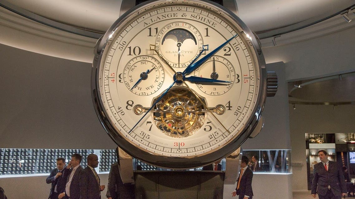 "People attend the ""Salon International de la Haute Horlogerie"" (SIHH) professional fair in fine watchmaking in Geneva. (File photo: AFP)"