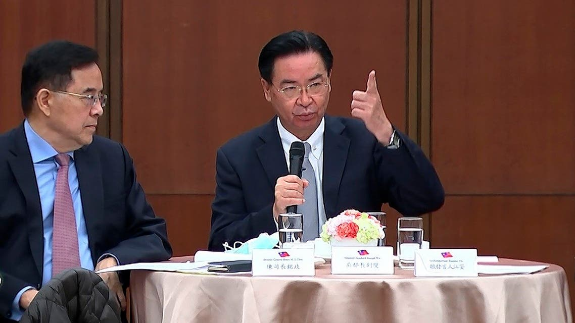 Taiwanese Foreign Minister Joseph Wu, right, speaks during a briefing Wednesday, April 7, 2021, in Taipei, Taiwan. Wu said that China's attempts at conciliation and military intimidation are sending mixed signals to people on the island China claims as its own territory to be won over peacefully or by force. (AP)
