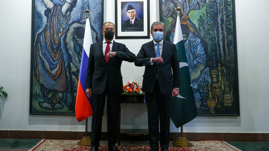 Russia's Foreign Minister Sergei Lavrov and his Pakistani counterpart Shah Mehmood Qureshi pose for a picture during a meeting in Islamabad, Pakistan, April 7, 2021. (Reuters)