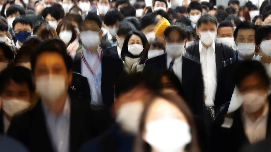 Commuters wearing protective face masks, amid the coronavirus disease (COVID-19) pandemic, make their way in Tokyo, Japan, April 6, 2021. Picture taken with slow shutter speed. REUTERS/Kim Kyung-Hoon