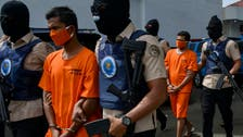 Indonesia sentences Iranian-led drugs gang of 12 to death by firing squad