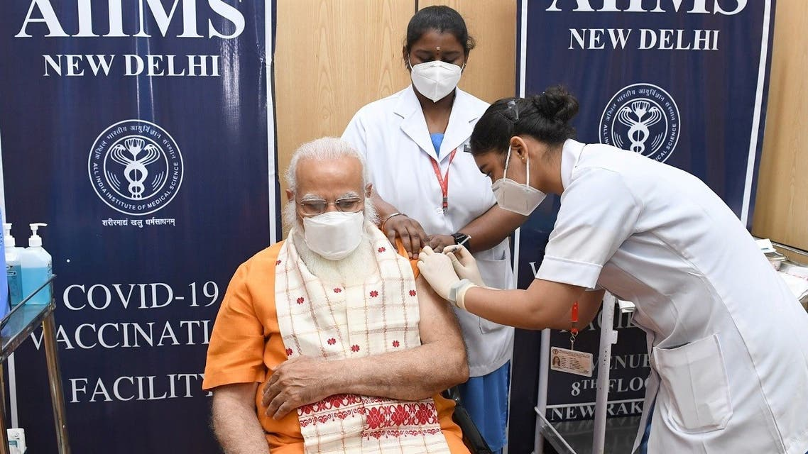 India's Prime Minister Narendra Modi receives his second dose of a coronavirus vaccine at the All India Institute of Medical Sciences (AIIMS) hospital in New Delhi, India, April 8, 2021. (Reuters)